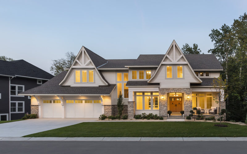 New house with two gables and stone accents on the front