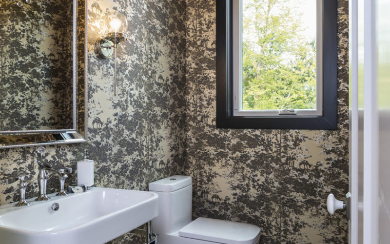 Small powder bathroom with patterned metallic wallpaper